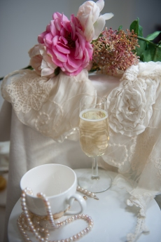 Glasses, teacups, lace.